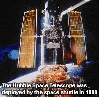 Hubble Space Telescope being deployed by the space shuttle